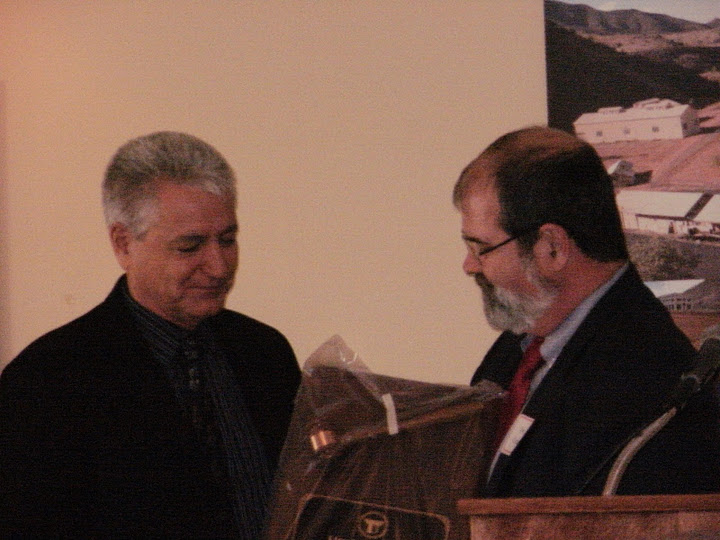 John passing the AZTLA Past President plaque to Lloyd Rabb