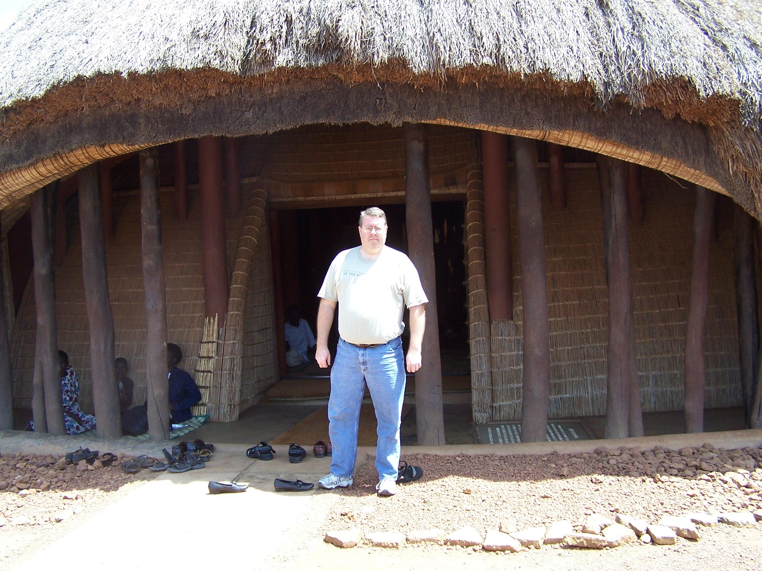 Evan Haglund in front of the tomb of Uganda\'s last king