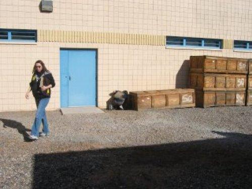 Expert inspecting crates at Estrella Jail.